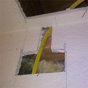 Run wire through wall to ceiling